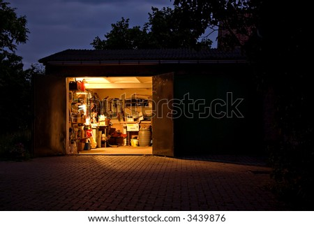 there is still light in the garage - stock photo
