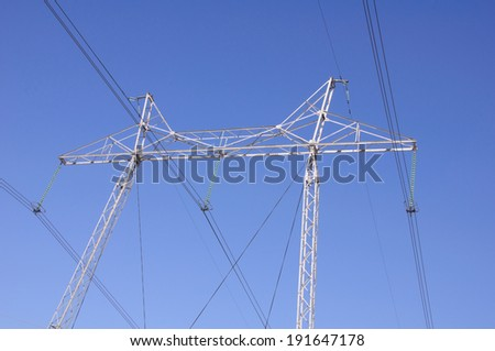 There is tangent tower with electric lines on blue sky background in Russia - stock photo