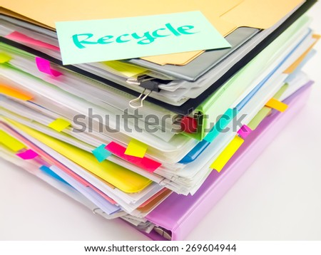 There is the huge pile of business documents on the desk. - stock photo