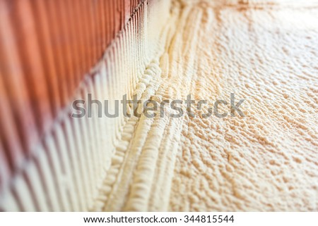 thermal and hidro insulation with spray foam at house construction site,  - stock photo