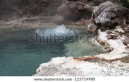 Thermal attraction in New Zealand showing boiling water - stock photo