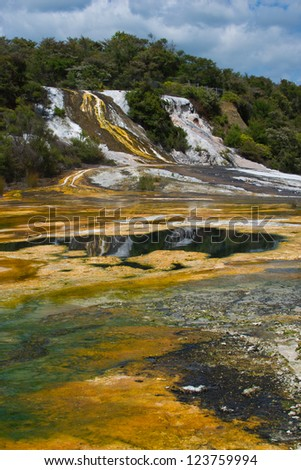 Thermal attraction in New Zealand showing silica overflows and green and yellow algae - stock photo