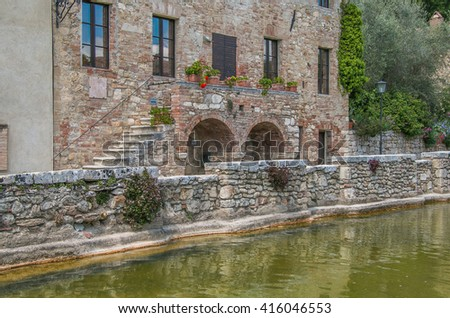 Thermal baths in the medieval village Bagno Vignoni, Tuscany, Italy - spa basin in the antique italian town.
