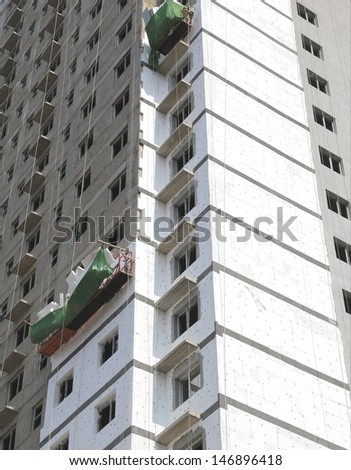Thermal exterior insulation of a building  - stock photo