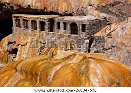 Thermal hotel ruins on Puente del Inca, near the entrance to Aconcagua Provincial Park, Mendoza, Argentina, South America - stock photo