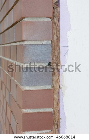 Thermal insulation of a house wall - stock photo