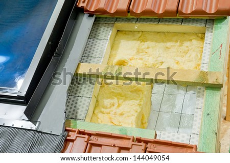 Thermal insulation of a roof  - stock photo