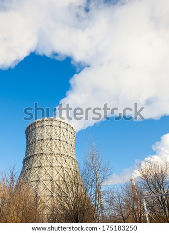 thermal power plant in winter against   sky - stock photo