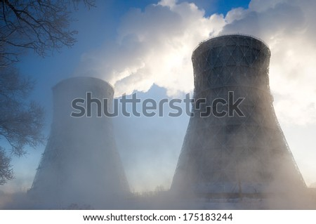 thermal power plant in winter in the fog - stock photo