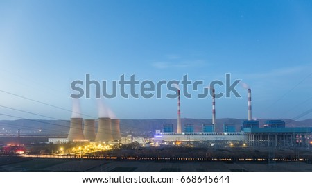 thermal power plant on loess plateau in nightfall , China