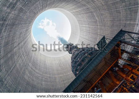 Thermal power plant with large chimney - stock photo