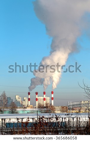 Thermal power plant with smoke rising from the chimneys