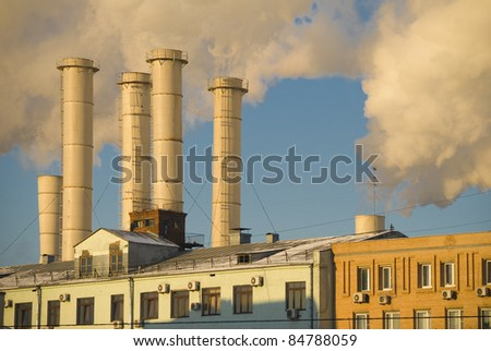 Thermal power station chimneys. An industrial building - stock photo