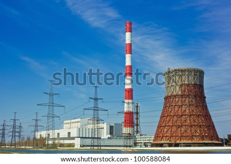 Thermal power stations and power lines on a clear day - stock photo