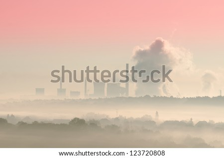 thermal station in the mist - stock photo