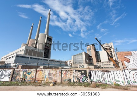 Thermoelectric plant in Sant Adria del Besos, Barcelona. Over time, the 3 chimneys have become  a  landmark for the skyline of Barcelona's urban area. - stock photo