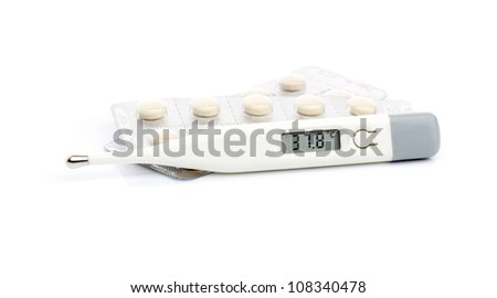 Thermometer and pills on white - stock photo