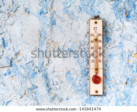 Thermometer on a blue wall, summer,heat, concept - stock photo