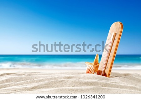 thermometer on a hot day, on the seashore with space for an advertising product or text