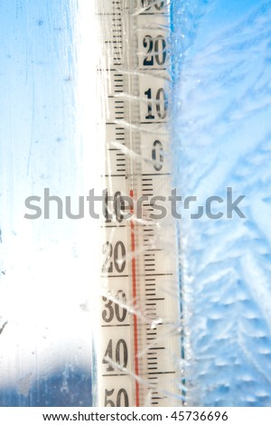 thermometer on icy window - stock photo