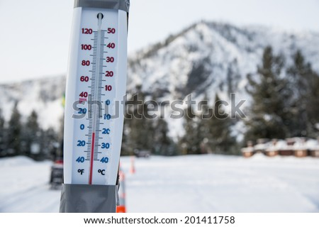 thermometer on sub-freezing winter day in yellowstone national park - stock photo