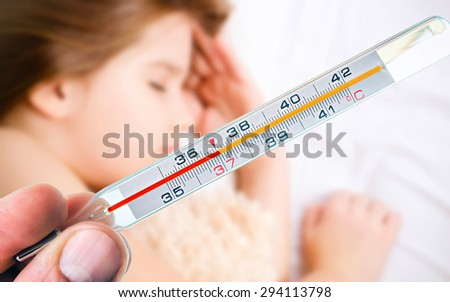 thermometer on the background of a sick child - stock photo