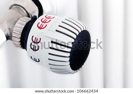 thermostat with eurosymbols as unit - stock photo