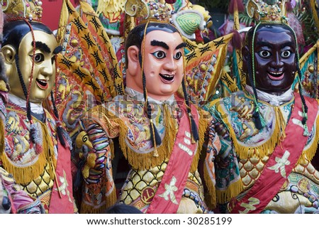 These are costumes worn by temple workers during parades. They form a core part of Chinese Culture. - stock photo
