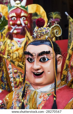 These are man-size costumes worn by temple workers during parades. They are popular in Taiwan. They form a core part of Chinese Culture. - stock photo