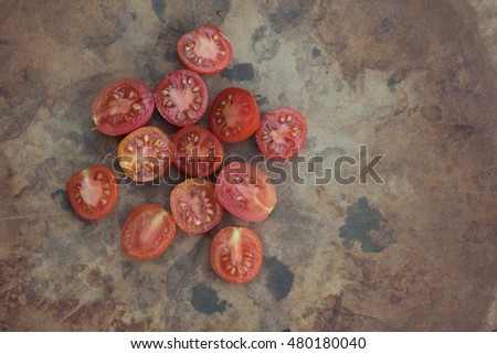These are sliced Matt's Wild Cherry Tomatoes and they are part of the species Lycopersicum esculentum.  Originally from Maine this species is very popular for garden growing in the summertime.