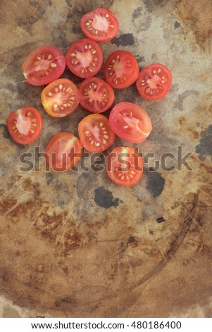 These are sliced Matt's Wild Cherry Tomatoes which are part of the species Lycopersicum esculentum.  Originally from Maine this species is very popular for garden growing in the summertime.