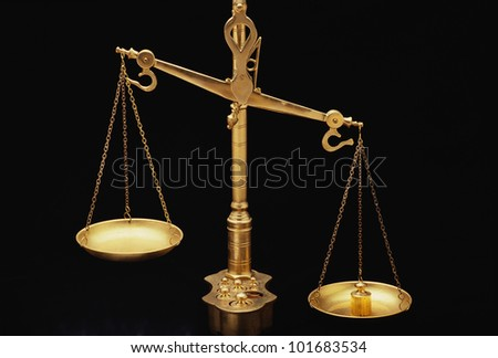 These are the golden Scales of Justice. They represent the legal system and courts. - stock photo