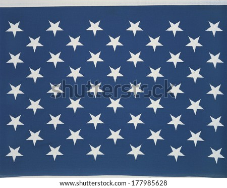 These are the stars of the American flag. They lay flat against their blue background. - stock photo