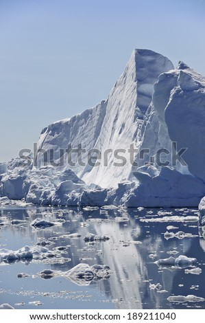 These icebergs are calved by the Jakobshavn glacier, and may stay in the icefjord for years, before floating North with the currents, eventually turning south and down into the Atlantic.  - stock photo