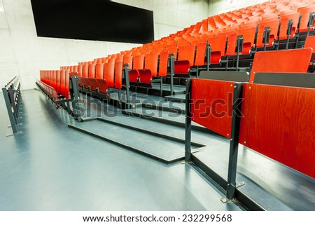 these red chairs in the auditorium from an school - stock photo