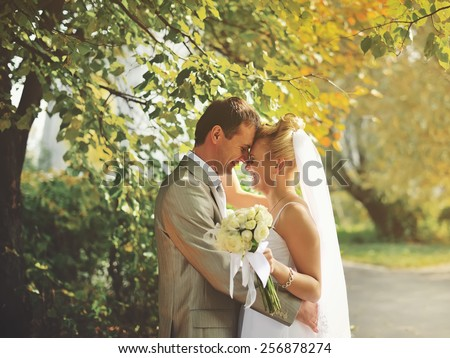 These romantic happy moments of wedding couple. - stock photo