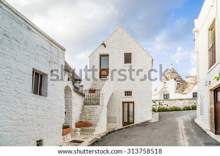 These typical houses with dry stone walls and conical roofs are unique to the world and projecting this place outside of time and reality, somewhere between magic and history
