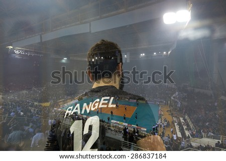 THESSALONIKI, GREECE, APRIL 23, 2015: Double exposure of Lucas Rangel during the Hellenic Volleyball League final games Paok vs Olympiacos at PAOK Sports Arena. - stock photo