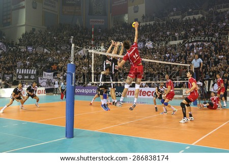 THESSALONIKI, GREECE, APRIL 23, 2015: General view of the players in action on the net during the Hellenic Volleyball League final games Paok vs Olympiacos at PAOK Sports Arena.