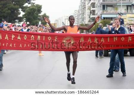 THESSALONIKI, GREECE - APRIL 6, 2014 : Runner KIMELI VICTOR KIPRONO finishing proudly in the 9th Marathon Alexander the Great. The marathon is an annual event. - stock photo