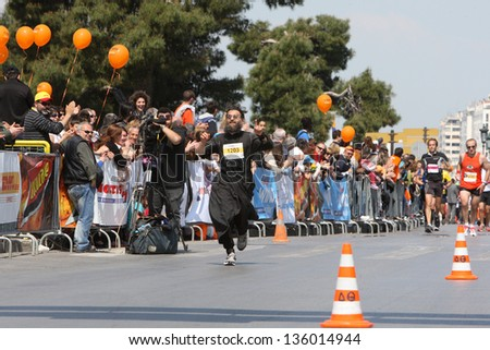 THESSALONIKI, GREECE - APRIL 21: 8th Marathon Alexander the Great Greek priest runner PERPERIDIS THEODOROS finishing proudly  on April 21,2013 in Thessaloniki, Greece - stock photo