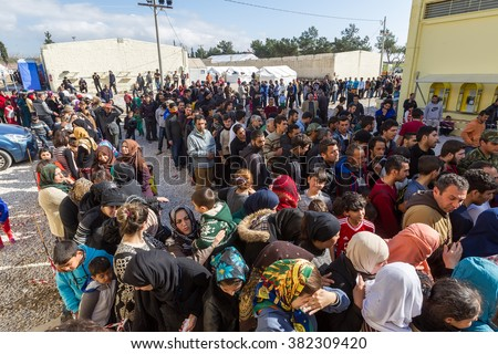 Thessaloniki, Greece - February 25, 2016: Refugees  living in tents in the center relocation Diavata waiting to continue  their journey the border between Greece and FYROM and from there to europe - stock photo