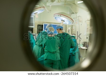 THESSALONIKI, GREECE, FEBRUARY 17, 2015: Team of doctors operates at patient in clinic center - stock photo