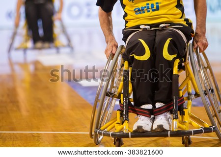 Thessaloniki, Greece - February 28, 2016: unidentified people play a friendly game of wheelchair basketball at Nick Galis stadium - stock photo