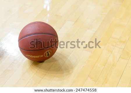 THESSALONIKI, GREECE - JAN 21, 2015: Basketball ball on the ground prior to the Eurocup game Paok vs Khimki in Paok Sports Arena.  - stock photo