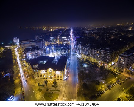 Thessaloniki, Greece - January 29, 2016: Aerial view of city Thessaloniki at night, Greece.. Image taken with action drone camera causing distortion and blur.