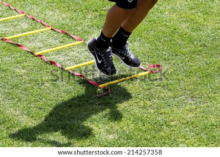 THESSALONIKI, GREECE - JULY 5, 2014: Close up to feet during training exercise of team Paok in Thessaloniki, Greece.