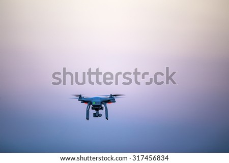 Thessaloniki, Greece, July 29, 2015: Drone quadrocopter Dji Phantom 3 Professional with high resolution digital camera (High quality 4K). New tool for aerial photo and video. - stock photo