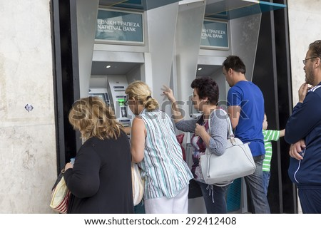 THESSALONIKI, GREECE,JULY 1 2015: People stand in a queue to use the ATMs of a bank. Greece's fraught bailout talks with its creditors took a dramatic turn, with the government announcing a referendum - stock photo