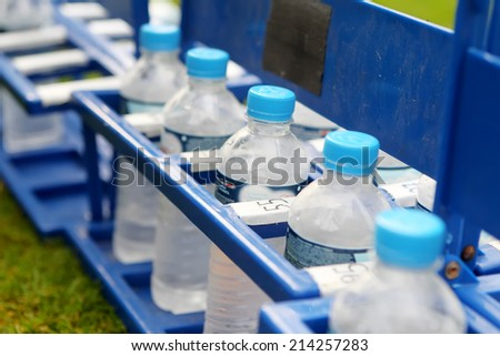 THESSALONIKI, GREECE - JULY 20, 2014: Water bottles in line for the players during Paok training in Thessaloniki, Greece.